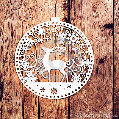 Christmas Card with White Christmas Ornaments on rustic wooden b