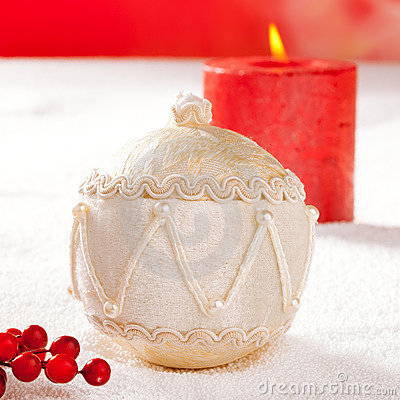 Christmas card of white velvet bauble and candle