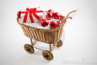 Christmas cart with red baubles and santa gift