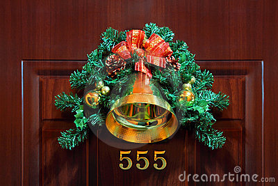Christmas composition with bellflower on door