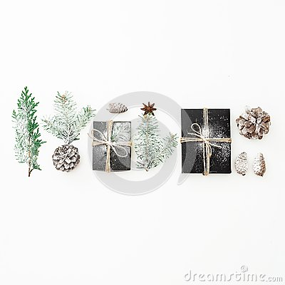 Free Christmas Composition Of Black Gift Box With Snow, Fir Branches And Pine Cones On White Background. New Year Concept. Flat Lay. To Stock Image - 106034811