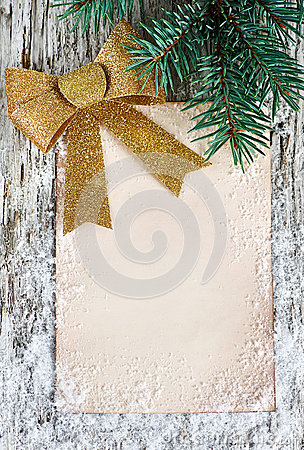 Christmas congratulation card with golden bow
