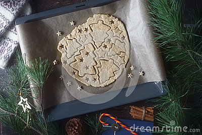 Christmas cookie preparation on the wooden table with different accessorizes Stock Photo