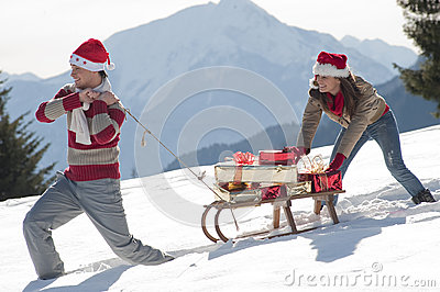 Christmas couple with sled and gifts