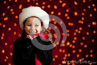 Little Christmas Girl On Red Stock Photo