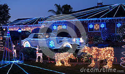 Christmas decorated house and dream luxury car