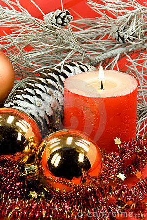 Christmas decoration with balls and lighted candle