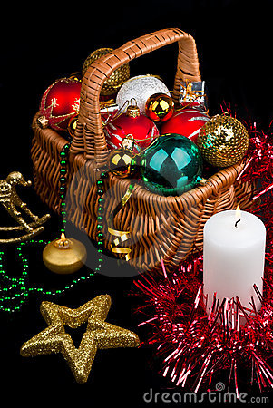 Christmas Decoration in basket and burning candle