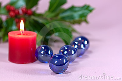 Christmas decoration with candle light,holly