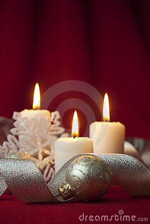 Christmas decoration with candles and ribbons