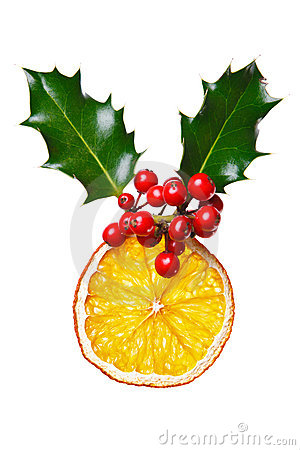 Christmas decoration with dried orange and holly.