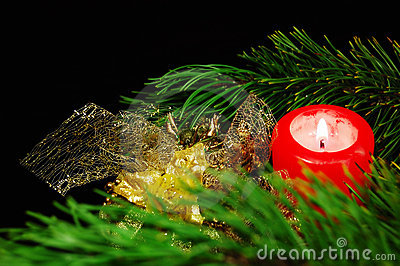 Christmas decoration: pine branch, candle, balls