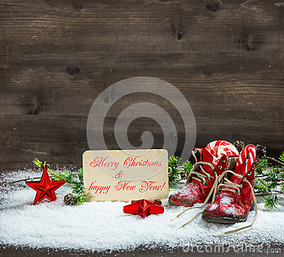 Free Christmas Decoration Red Stars And Antique Baby Shoes In Snow Royalty Free Stock Photos - 34026878