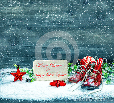 Free Christmas Decoration Red Stars And Antique Baby Shoes In Snow Royalty Free Stock Image - 47447396