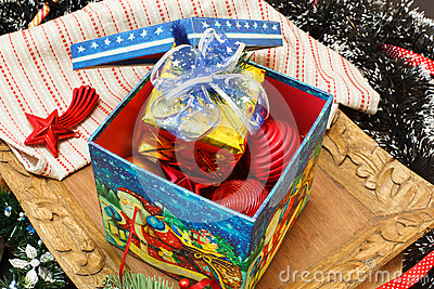 Christmas decorations in the box and gift box on top