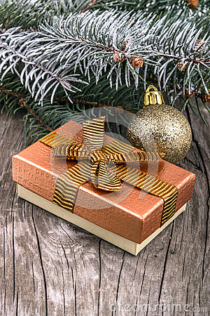 Christmas decorations and gift box on wood