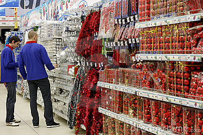 Employees are watching christmas decorations displayed for sale in