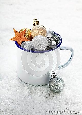 Christmas decorations in a tin mug