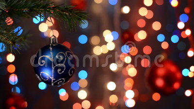 Christmas decorations on tree, branch, bokeh background, out of focus lights. Christmas and Happy New Year defocused abstract background. Very shallow deep of stock video footage