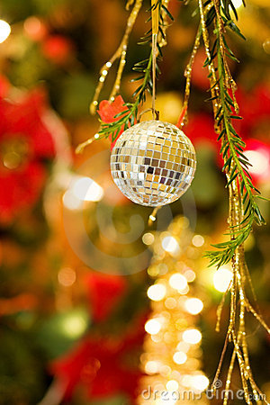Christmas disco ball over defocused tree