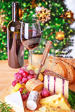 Romantic cheese and wine table setting winter holidays celebration