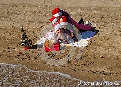 Christmas family at sand beach