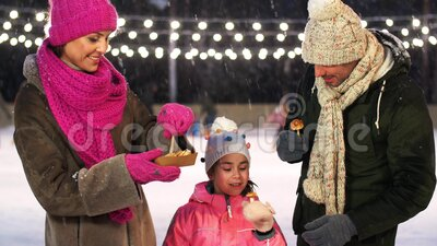 happy family eating pancakes on skating rink stock video