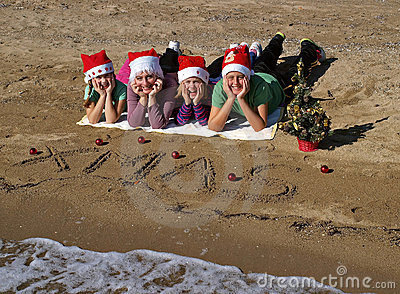 Christmas family on sand beach