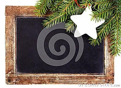 Christmas Fir branch on Vintage Christmas Blackboard frame  isol
