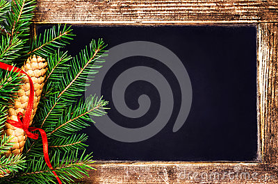 Christmas  Fir Tree Branch and pine cone on  Vintage Blackboard
