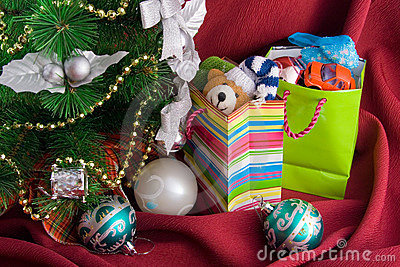 Christmas fur-tree and  packages with gift