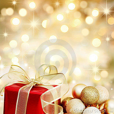 Christmas gift and baubles on golden background