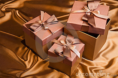 Christmas gift box on yellow bright satin