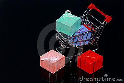 Christmas Gift boxes in shopping cart isolated