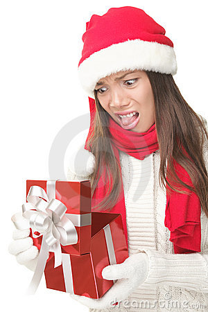 Free Christmas Gift Woman Unhappy Opening Present Royalty Free Stock Image - 16123386