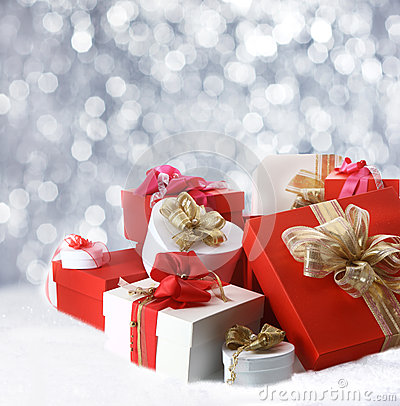 Free Christmas Gifts Against Sparkling Party Lights Royalty Free Stock Photography - 34307627