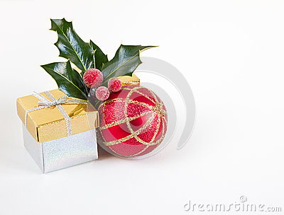 Christmas gifts, bauble and holly