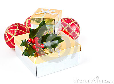 Christmas gifts, baubles and holly