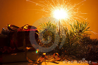 Christmas gifts closeup and bengal sparkler