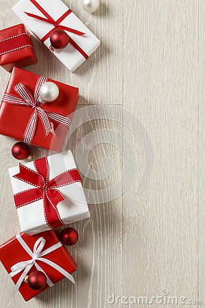 Free Christmas Gifts Presents On Rustic Wood Background. Simple, Red And White Gift Boxes Festive Holiday Border. Stock Image - 79185291