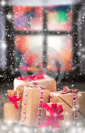 Free Christmas Gifts Rustic Table Window Dark Snowing Stock Images - 48060204