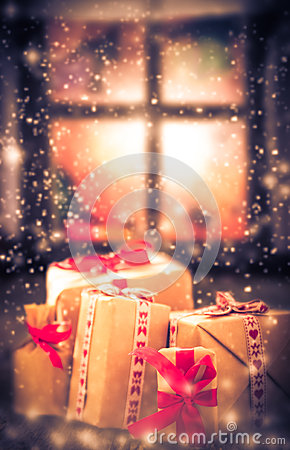 Free Christmas Gifts Rustic Table Window Dark Snowing Royalty Free Stock Image - 48060206