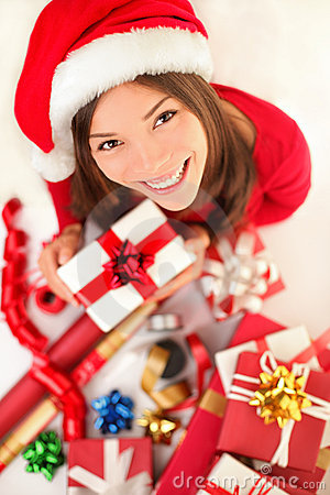 Christmas gifts - woman wrapping christmas gift