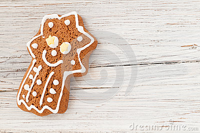 Christmas gingerbread comet on wooden background