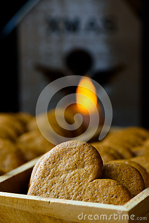 Free Christmas Gingerbread Pepper Cookies In Wood Box. Lit Candle With Angel Figure In The Background. Cozy Festive Atmosphere Stock Images - 98353504
