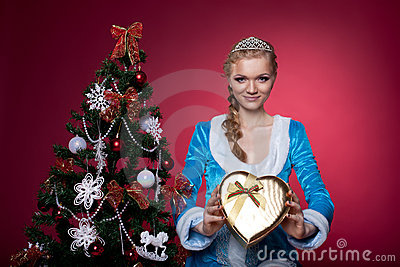 Christmas girl in blue sexy cloth with present