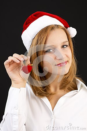 Christmas girl with christmas decoration (red heart)