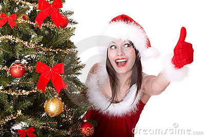 Christmas girl and fir tree with thumb up.