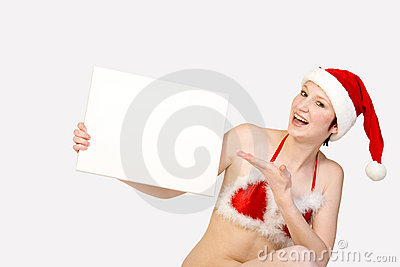 Christmas girl holding up a white sign for copyspa