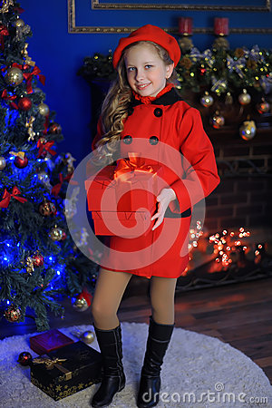 Free Christmas Girl In A Red Beret And Coat Royalty Free Stock Photos - 64939038